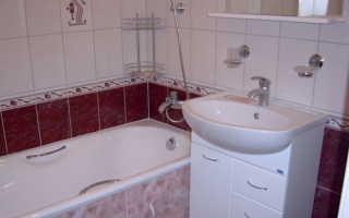 На какой высоте устанавливается смеситель над ванной?
